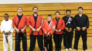 BJJ Pose: Alan, Cris, Isaiah, Jayden, and Jesus with their new Brown Belts