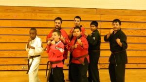 Fighting Stance: Alan, Cris, Isaiah, Jayden, and Jesus with their new Brown Belts